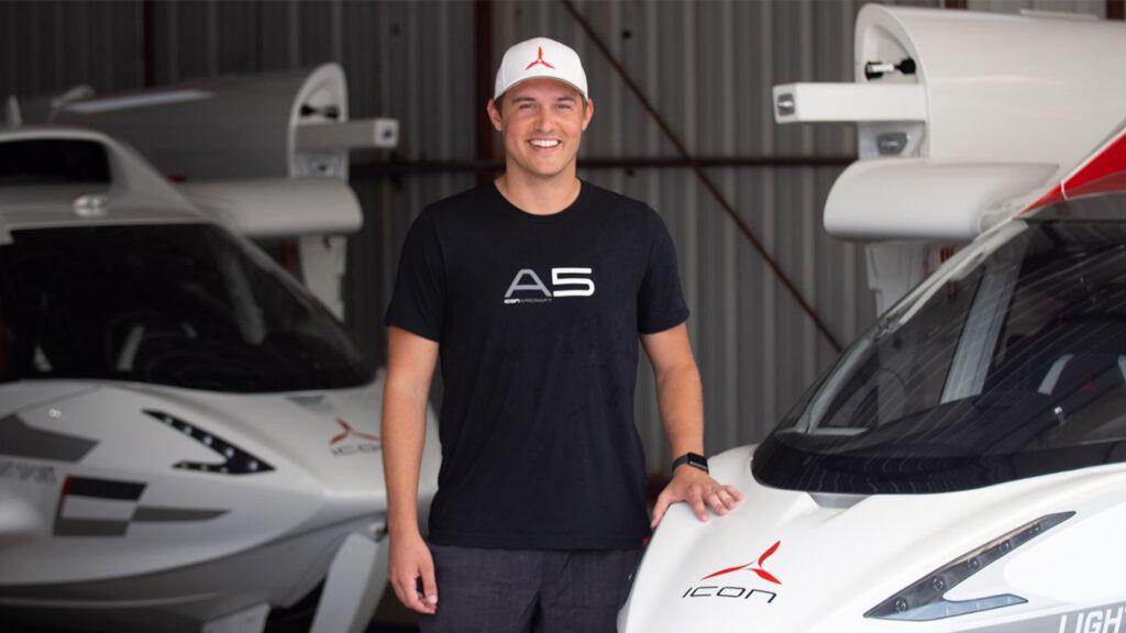 Peter Weber Bachelor standing next to an A5 Airplane.