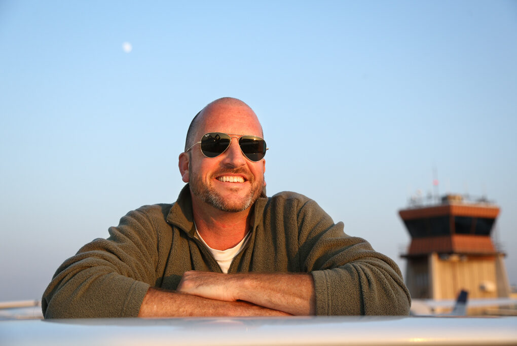 Jason Miller, one of the best known Certified Flight Instructors in general aviation, leaning against an airplane wing.